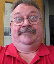 Bill holding camera.