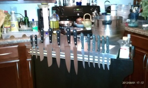 Knives on the magnetic holder on the island, from the back.
