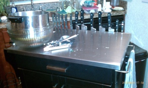 Knives on magnetic holder on kitchen island, from the workside.